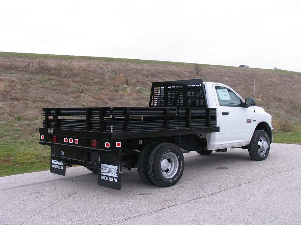PG-93B Westerner Flatbed on a Ram 3500 with BHTS Series Bulkhead and steel stake racks.